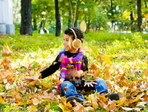 African american boy sitting outdoors Royalty Free Stock Images