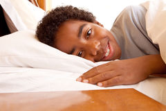 African American boy sleeping in his bed. Stock Photo