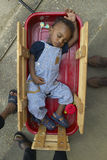 African-American boy sleeping in little Red Wagon in Central GA Royalty Free Stock Photos