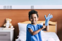 African american boy wearing medical glove Royalty Free Stock Image