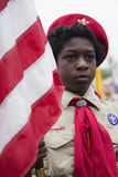 African American Boyscout display US Flag at solemn 2014 Memorial Day Event, Los Angeles National Cemetery, California, USA Royalty Free Stock Image