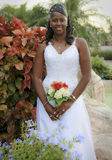 African american bride. An african american bride smiling holding her bouquet of flowers royalty free stock photo