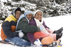 Free African American Brothers And Sister Sliding On A Sled. Royalty Free Stock Photos - 89496508