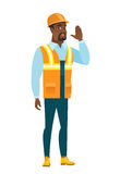 African-american builder calling for help. Royalty Free Stock Photography