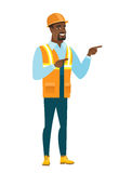 African-american builder pointing to the side. Royalty Free Stock Photography