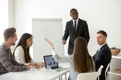 African american business coach answering questions at corporate. African american business coach speaker answering questions at corporate office training, black stock photo