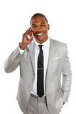 African american business male talking on cell phone. Young african american business male talking on cell phone isolated on white Royalty Free Stock Images
