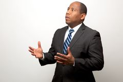 African American Business Man With Both Hands Signaling a Request for Explanation. On Light Background stock image