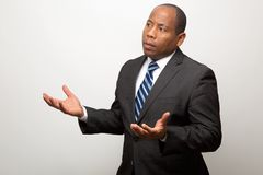 African American Business Man With Both Hands Signaling a Request for Explanation. On Light Background stock images