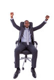 African american business man with clenched fist over white back Royalty Free Stock Photography