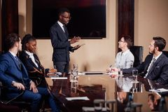 African American Business Man Giving Presentation To Associates Royalty Free Stock Photos
