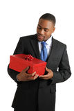 African american business man holding a gift Stock Photos