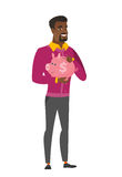African-american business man holding piggy bank. Stock Photo