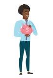 African-american business man holding piggy bank. Stock Photos