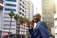African american business man talking on mobile phone in the city Royalty Free Stock Photo