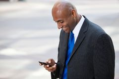 African American Business Man Texting Stock Image