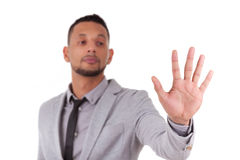 African American business man touching a transparent screen - Bl. Ack people, isolated on white background Royalty Free Stock Photography