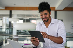 African American business man using digital tablet. Stock Images