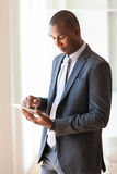 African american business man using a tactile tablet -Black peop Royalty Free Stock Image