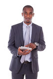 African american business man using a tactile tablet over white Royalty Free Stock Images