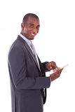 African american business man using a tactile tablet over white Stock Images