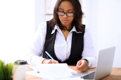 African american business woman is busy with paper job in office Royalty Free Stock Images
