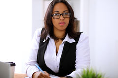 African american business woman is busy with paper job in office Stock Image