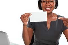 African-American business woman with card. Afro american business woman with paper card isolated white background Royalty Free Stock Image