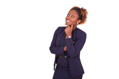 African American business woman with folded arms looking up , i. Solated on white background - Black people royalty free stock photos