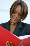 African american business woman with folder Stock Photos