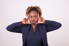 African American business woman grimacing making frame gesture w royalty free stock photo