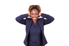 African American business woman hiding her hears with her hands Stock Images
