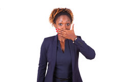 African American business woman hiding her mouth with her hand. Over white background Stock Images
