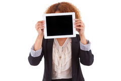 African American business woman holding a tactile tablet - Black Royalty Free Stock Photography