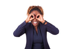 African American business woman making binocular gesture with he Stock Photo