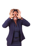 African American business woman making binocular gesture with he Stock Photography
