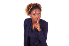 African American business woman making silence gesture with her. Finger Royalty Free Stock Photos