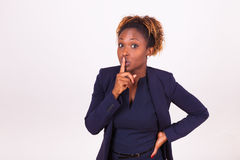 African American business woman making silence gesture with her. Finger Royalty Free Stock Photography