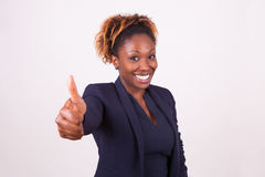 African American business woman making thumbs up gesture - Black Royalty Free Stock Photos