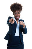 African american business woman pointing at camera Stock Photo