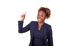 African American business woman pointing something up - Black pe Royalty Free Stock Photography