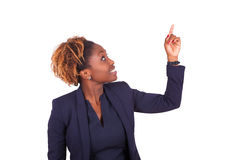 African American business woman pointing something up - Black pe Stock Photo