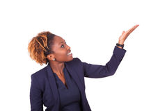 African American business woman pointing something up - Black pe Royalty Free Stock Photo