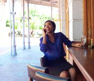 African american business woman smiling with mobile phone Stock Photo