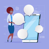 African American Business Woman Stand With Big Cell Smart Phone Social Network Communication Businesswoman With Chat royalty free illustration
