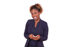 African American business woman using a smartphone - Black peopl Stock Photos