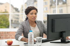 African American business woman working with computer Stock Photos