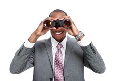 African-American businessman with binoculars. Royalty Free Stock Image