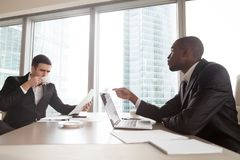 Black financial consultant talking with investor Royalty Free Stock Photo