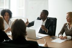 African-american businessman disagreeing with contract terms at. African american businessman disagreeing with contract terms at group multi-ethnic negotiations Stock Images